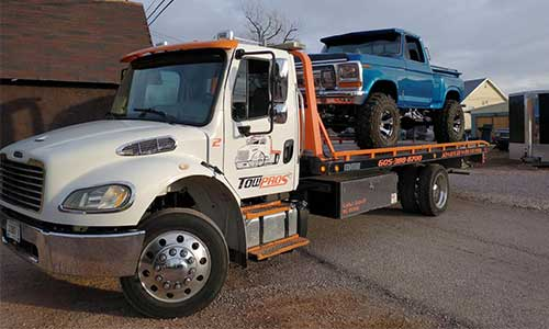 Tow Pros Tow Truck Towing A Pickup Truck
